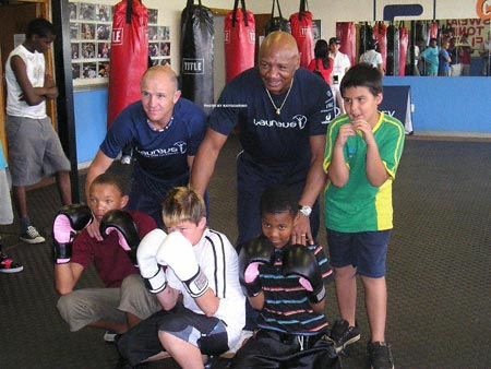 Marvelous and Mr.Gilmore with group of kids at the Gilmore Gym in South Africa. 